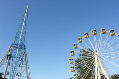 Ferris wheel against a blue sky in the amusement park - stock photo