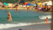 Stock Video Footage of Blurred people enjoying themselves at the beach in slow motion