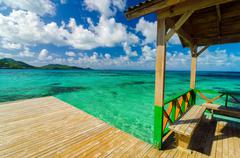 Wooden Dock and Turquoise Water - stock photo