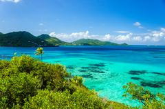 Beautiful Sea and Tropical Island - stock photo