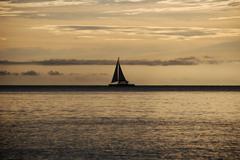 Sailing at sundown - stock photo
