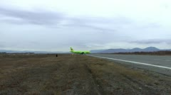 The passenger plane goes to the runway end for fast take-off Stock Footage