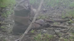 Old boots drags across the uneven ground - 1080p HD Stock Footage