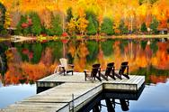 Stock Photo of wooden dock on autumn lake