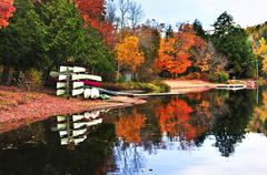 fall forest reflections with canoes - stock photo