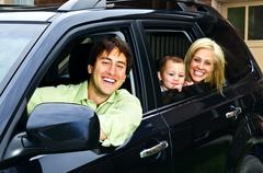 Happy family in car Stock Photos