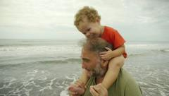 Grandpa & Grandson playing at the beach - stock footage