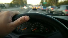 Hand on steering wheel Stock Footage