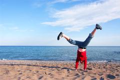 girl doing cartwheel - stock photo