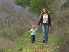 Mother and daughter walking and playing on the forest. - stock footage
