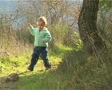 Little girl walking and playing in the forest Footage