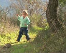 Little girl walking and playing in the forest Stock Footage