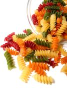 Stock Photo of tricolor pasta on white