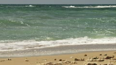 Waves rolling over the beach - stock footage