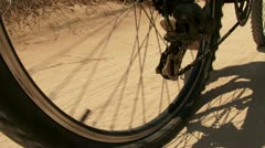 Bicycle rear wheel sniping on the sand. Stock Footage