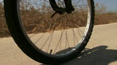 Bicycle front wheel sniping Stock Footage