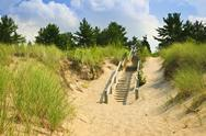 Stock Photo of wooden stairs over dunes at beach