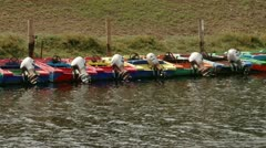 Anchored motorboats on a river. Stock Footage