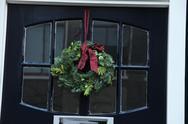 Christmas wreath on a door Stock Photos