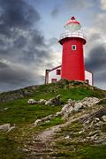 lighthouse on hill - stock photo