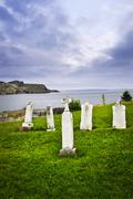 tombstones near atlantic coast in newfoundland - stock photo