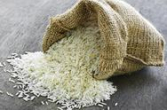 Stock Photo of long grain rice in burlap sack
