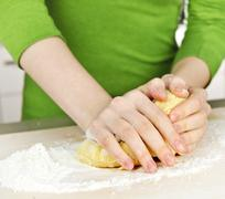 Stock Photo of hands kneading dough