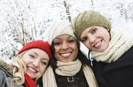 Stock Photo of group of girl friends outside in winter