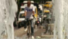 Bicycle, Cars and people passing over a fountain Stock Footage