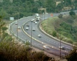 Cars passing by on freeway curve Stock Footage
