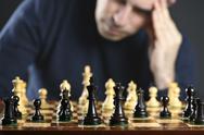 Man at chess board Stock Photos