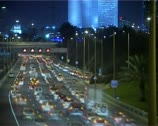 Bridge over highway night traffic time-lapse Stock Footage