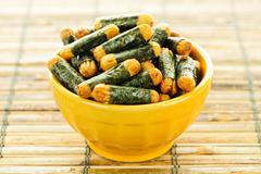 rice and seaweed crackers nori maki - stock photo