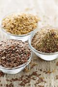 brown and golden flax seed - stock photo