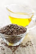 Stock Photo of brown flax seed and linseed oil