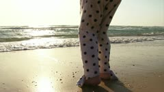 Girl playing with waves at the beach Stock Footage