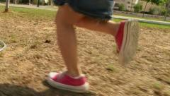 Girl running at playground / park in slow motion Stock Footage