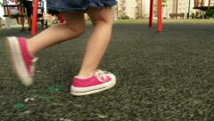 Girl running at playground / park in slow motion - stock footage