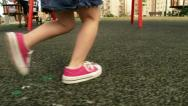 Stock Video Footage of Girl running at playground / park in slow motion