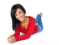 young woman smiling laying down - stock photo