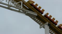 Roller Coaster at crest Stock Footage