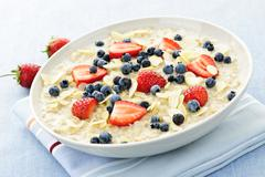 oatmeal breakfast cereal with berries - stock photo