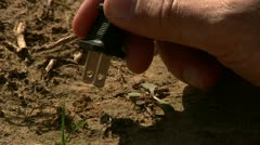 Plugging 110v plug to dry soil. Stock Footage