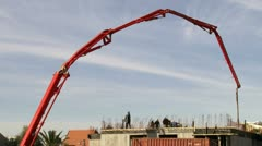 Crane Filling structure with cement / concrete. - stock footage