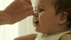 A Child, baby, boy, being feed by his mother Stock Footage