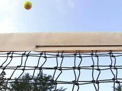 Tennis ball passing over the net. Slow Motion. Stock Footage