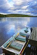 Rowboat docked on lake Stock Photos