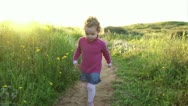 Stock Video Footage of Girl Running on flowered Valley