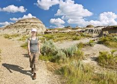 Hiker in badlands of alberta, canada Stock Photos