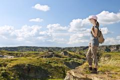 hiker in badlands of alberta, canada - stock photo